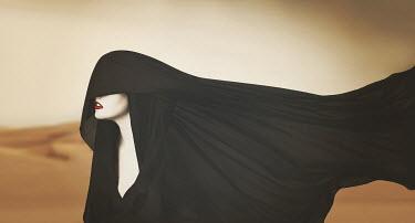 Vanessa Paxton WOMAN IN DESERT WITH HEADSCARF Women