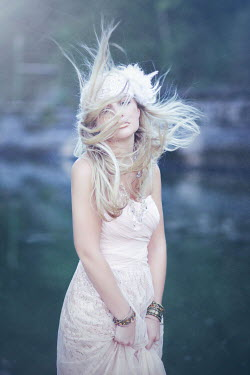 Rachel Nichole WOMAN IN DRESS WITH HAIR BLOWING IN WIND Women