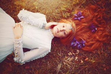 Rachel Nichole WOMAN WITH FLOWERS IN HAIR LYING DOWN Women