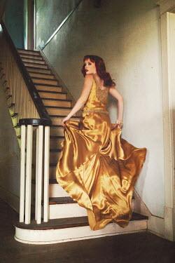 Rachel Nichole WOMAN IN VINTAGE DRESS ON STAIRS Women
