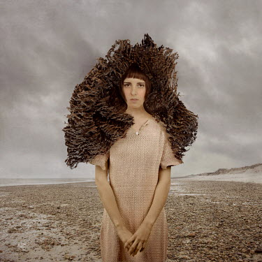 Jennifer Hudson WOMAN WITH SCULPTURE ON HEAD ON BEACH Women