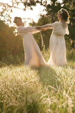 Dana France TWO HISTORICAL WOMAN IN SUNLIT FIELD Groups/Crowds