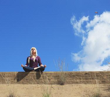 Sigrid Kolbe WOMAN MEDIATING UNDER BLUE SKY Women