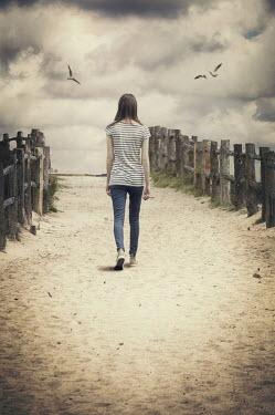 Nicola Smith GIRL WALKING ON SANDY PATH Women
