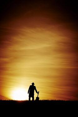 John Herbert Harrison SILHOUETTE OF MAN WITH GUITAR AT SUNSET Men