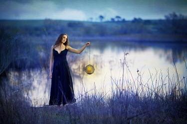 Pini Hamou WOMAN WITH LANTERN BY LAKE Women