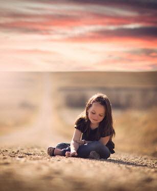 Jake Olson LITTLE GIRL SITTING ON DIRT ROAD Children