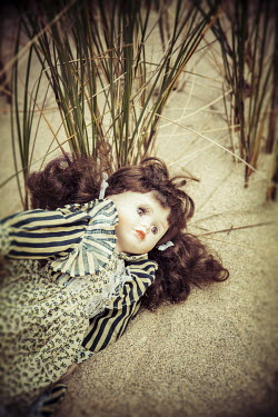 Nic Skerten ABANDONED DOLL IN SAND Miscellaneous Objects