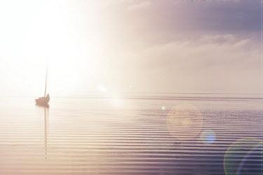 Marta Nardini BOAT ON WATER AT SUNSET Boats