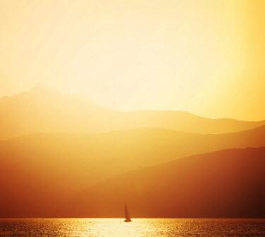 Marta Nardini BOAT ON LAKE AT SUNRISE Boats
