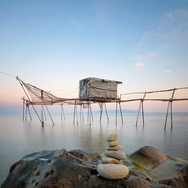 Mustafa Dedeoglu SHACK ON STILTS OVER WATER Miscellaneous Buildings