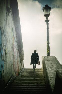 Yolande de Kort MAN WITH BRIEFCASE ON STONE STEPS Men