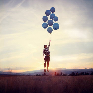 Joel Robison MAN WITH BALLOONS FLOATING ABOVE COUNTRYSIDE Men