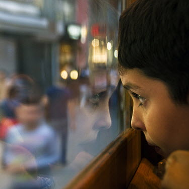 Mustafa Dedeoglu BOY LOOKING OUT OF TRAIN WINDOW Children
