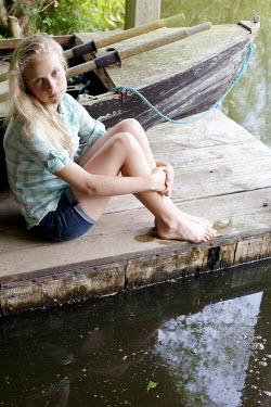 James Walker GIRL SITTING ON WOODEN JETTY Children