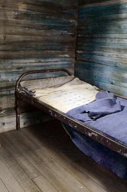 Jill Battaglia BED IN WOODEN CABIN Interiors/Rooms