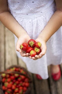 Karina Simonsen GIRL HOLDING STRAWBERRIES Children