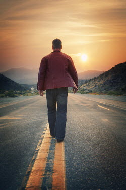 Dave Curtis MAN WALKING ON ROAD AT SUNSET Men