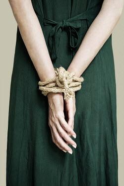 Yolande de Kort WOMAN WITH HANDS TIED WITH ROPE Women