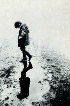 John Cooper LITTLE BOY WALKING IN PUDDLE Children