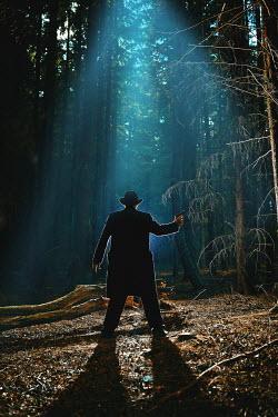 John Herbert Harrison SILHOUETTE OF MAN WITH GUN IN FOREST Men