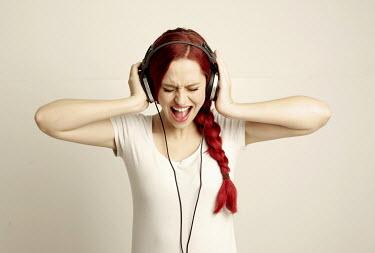 Jessica Truscott YOUNG WOMAN WEARING HEADPHONES Women
