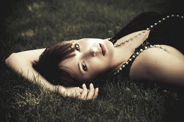 Megan Bettinger YOUNG WOMAN LAYING ON GRASS Women