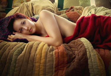 Megan Bettinger YOUNG WOMAN LYING ON COUCH Women
