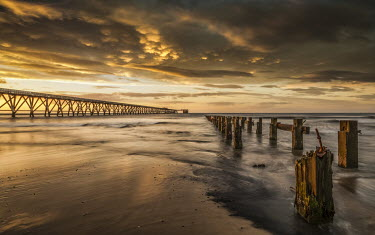 Graham Hunt PIER AND EMPTY BEACH AT SUNSET Seascapes/Beaches
