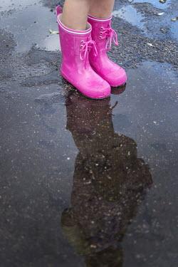 Karina Simonsen LITTLE GIRL STANDING IN PUDDLE Children