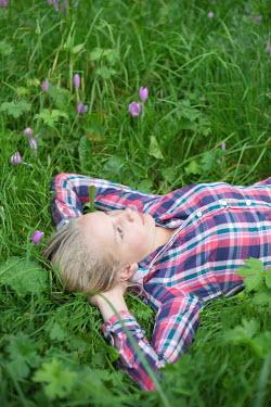 James Walker TEENAGE GIRL LYING ON GRASS Women