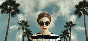 Lidia Vives Rodrigo WOMAN WITH SUNGLASSES BY PALM TREES Women