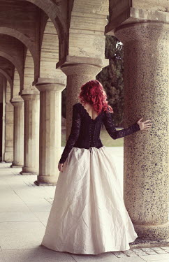 Jessica Truscott YOUNG WOMAN BY STONE COLUMNS Women