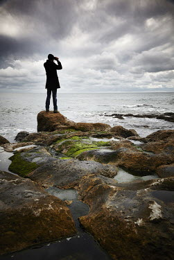 Andy & Michelle Kerry MAN ON ROCKS LOOKING OUT TO SEA Men