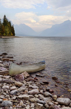 Jill Battaglia CANOE ON ROCKY SHORE OF LAKE Boats
