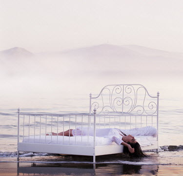 Rebeca Cygnus WOMAN ON BED ON BEACH Women