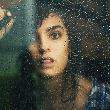 Rebeca Cygnus WOMAN LOOKING THROUGH WET WINDOW Women