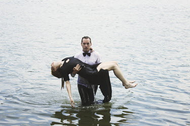 Jovana Rikalo MAN CARRYING WOMAN OUT OF WATER Couples