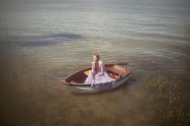 Vivienne Mok WOMAN IN BOAT ON LAKE Women