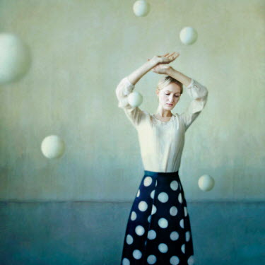 Olga Astratova WOMAN SURROUNDED BY FLYING BALLS Women