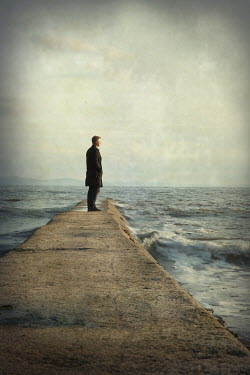 Dave Curtis MAN ON STONE PIER BY SEA Men