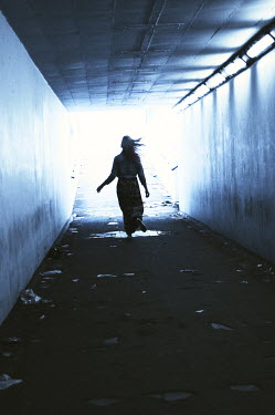 Thomas Szadziuk SILHOUETTE OF WOMAN RUNNING IN TUNNEL Women