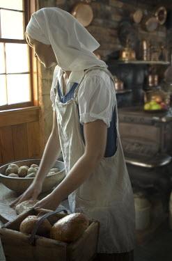 Debra Lill WOMAN WORKING IN KITCHEN Women