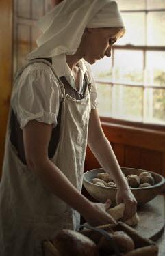 Debra Lill WOMAN IN KITCHEN Women