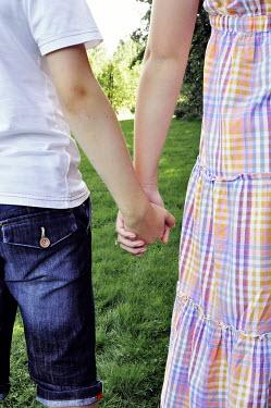 Thomas Szadziuk YOUNG COUPLE HOLDING HANDS Couples