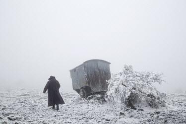 Carmen Spitznagel WOMAN IN SNOWY FIELD WITH OLD CART Women
