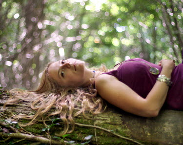 Natalie Miller BLOND WOMAN LYING ON TREE Women