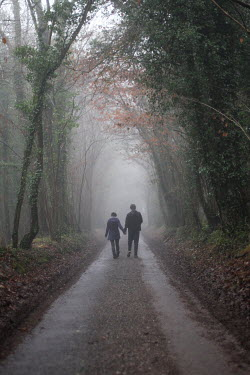 Natalie Miller COUPLE WALKING ON COUNTRY PATH Couples