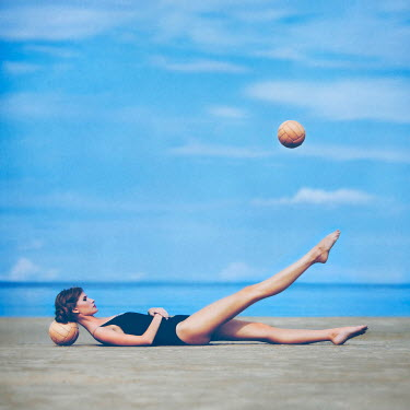 Olga Astratova WOMAN ON BEACH WITH BALLS Women