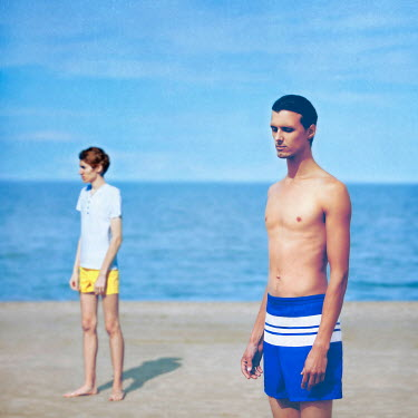 Olga Astratova TWO YOUNG MEN ON BEACH Groups/Crowds